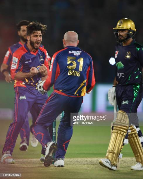 Cricketer Usman Shinwari of Karachi Kings celebrates with teammates after taking wicket of Ahmed Shahzad of Quetta Gladiators during the second match...