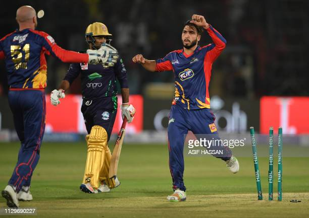 Cricketer Usman Shinwari of Karachi Kings celebrates with teammates after bowling out to Sarfaraz Ahmed of Quetta Gladiator during the second match...