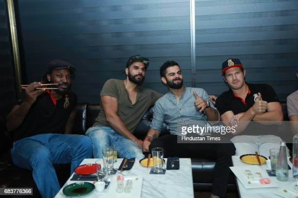Cricketer Virat Kohli with his Royal Challengers Bangalore teammates Chris Gayle and Shane Watson during special dinner at his new restaurant Nueva...