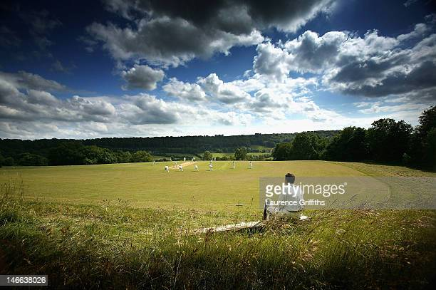 A Cricketer waits for his turn to bat at Sheepscombe Cricket Club on June 14 2005 in Sheepscombe England