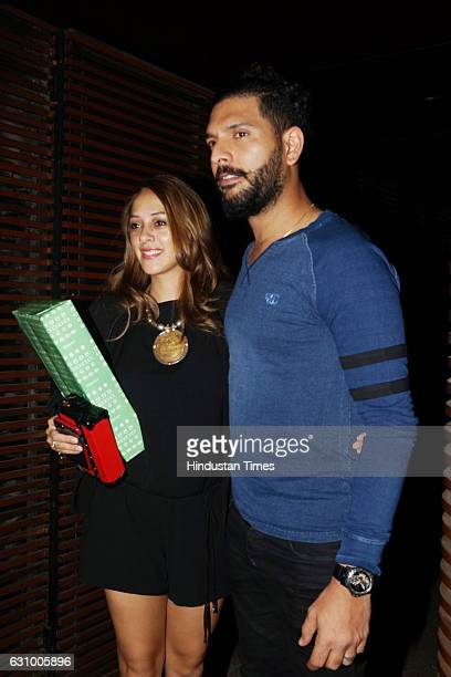 Cricketer Yuvraj Singh with his wife Hazel Keech during a dinner party hosted by Subroto Roy and his family at a restaurant in Juhu on January 3 2017...