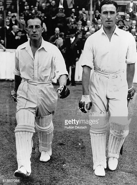 Cricketers Dennis Compton and Bill Edrich walk out to open the batting for Middlesex the champion county of England in a match against the rest of...