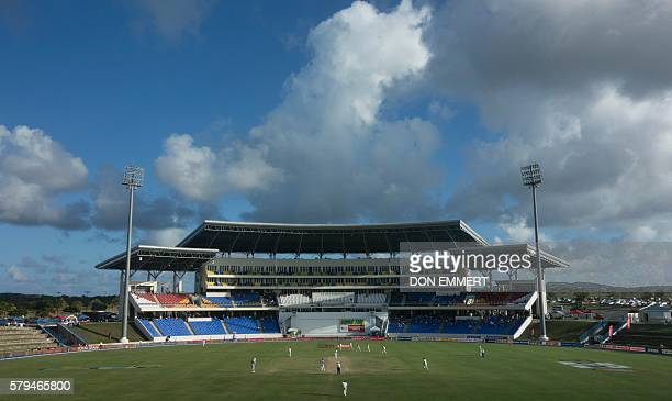 Cricketers from India and West Indies play during day three of the cricket test match between West Indies and India on July 23 2016 at Sir Vivian...