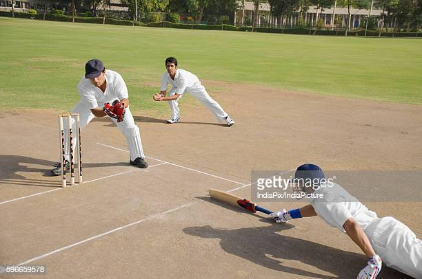 Cricketers in action