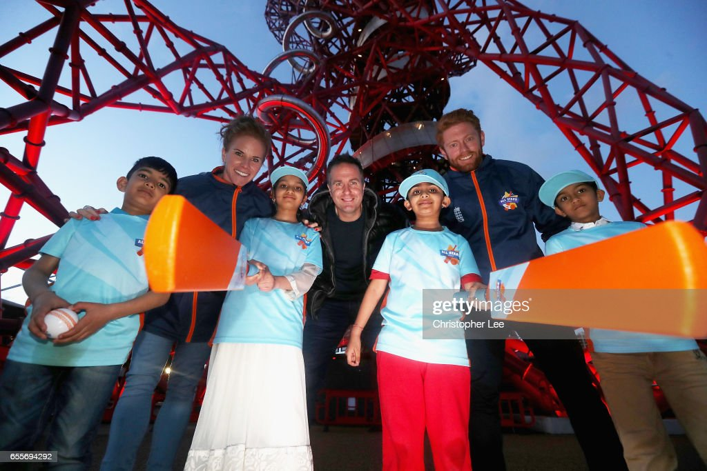 Cricketers Lauren Winfield, Michael Vaughan and Jonny Bairstow pose for the camera with pupils from Elmhurst Primary School during the ECB All Stars Cricket Event at the ArcelorMittal Orbit at Queen Elizabeth Olympic Park on March 20, 2017 in London, England.