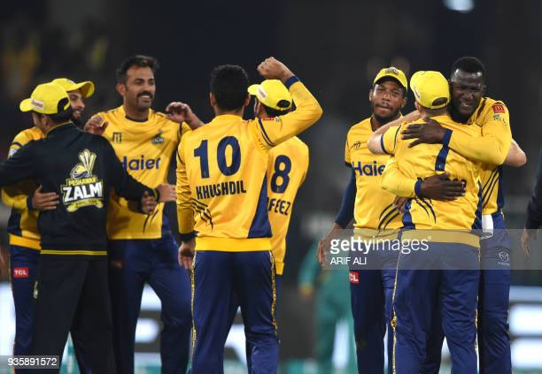 Cricketers of Peshawar Zalmi celebrate after winning the Twenty20 cricket match of the Pakistan Super League against Karachi King at The Gaddafi...