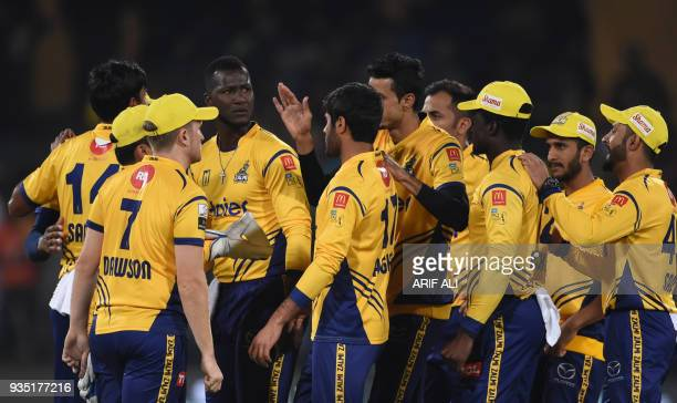 Cricketers of Peshawar Zalmi celebrate the dismissal of Sarfraz Ahmed from Quetta Gladiators during the PSL T20 cricket match in the Gaddafi Stadium...