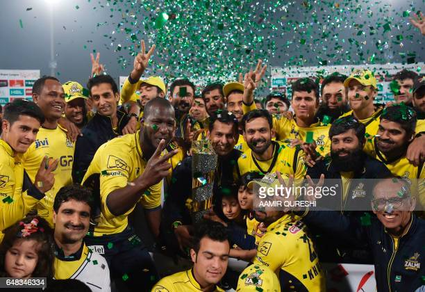 Cricketers of Peshawar Zalmi celebrate their victory over Quetta Gladiators in the final cricket match of the Pakistan Super League at The Gaddafi...