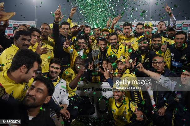 TOPSHOT Cricketers of Peshawar Zalmi their victory over Quetta Gladiators in the final cricket match of the Pakistan Super League at The Gaddafi...