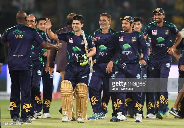 Cricketers of Quetta Gladiators celebrate the victory in the final of Twenty20 Pakistan Super League at the National Cricket Stadium in Karachi on...