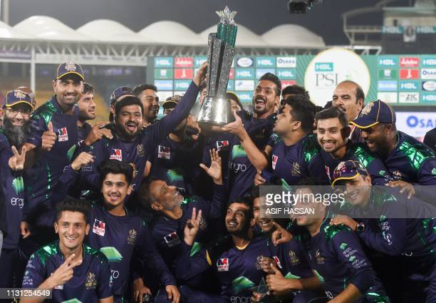 Cricketers of Quetta Gladiators celebrates their victory in the final of Twenty20 Pakistan Super League cricket match at the National Cricket Stadium...