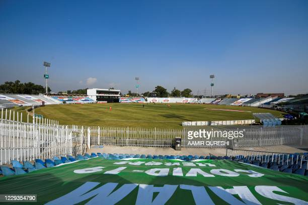 Cricketers play in an empty stadium due to the Covid-19 coronavirus pandemic during the first one-day international cricket match between Pakistan...
