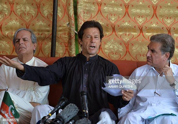 Cricketer-turned politician and chairman of Pakistan Tehreek-e-Insaf or Movement for Justice party, Imran Khan speaks during a press conference at...