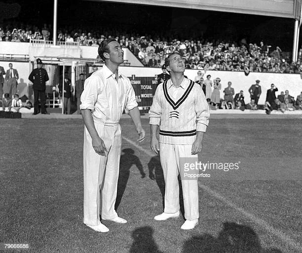 Cricket/Football 12th August 1949 Denis Compton and WJEdrich of Middlesex toss for Ends before a cricket match on Arsenals Highbury pitch for the...