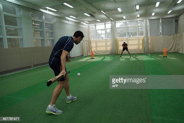 CricketHKGT20FEATURE by Issam AHMED In this photo taken on December 7 Hong Kong's international squad coach Mark Wright hits a ball to team player...