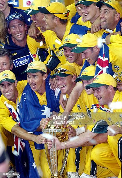 CricketWC2011history2003 This picture taken on March 23 2003 shows the Australian cricket team celebrating with the trophy after winning the final of...