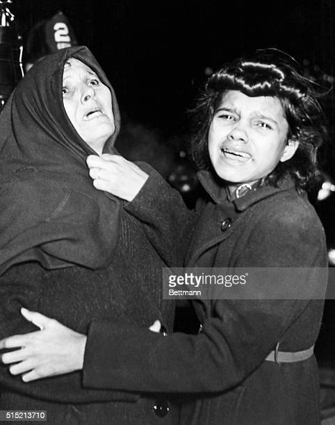 7/27/1945 'I cried when I took this picture' says Weegee Mother and daughter weep and look up hopelessly as another daughter and her young baby are...