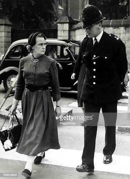 12th July 1955 Mrs Neilson the mother of Ruth Ellis leaving Holloway Prison escorted by a policeman Ruth Ellis was hanged on 13th July 1955 for the...