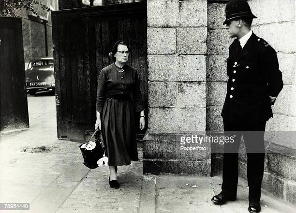 12th July 1955 Mrs Neilson the mother of Ruth Ellis leaving Holloway Prison watched by a policeman Ruth Ellis was hanged on 13th July 1955 for the...