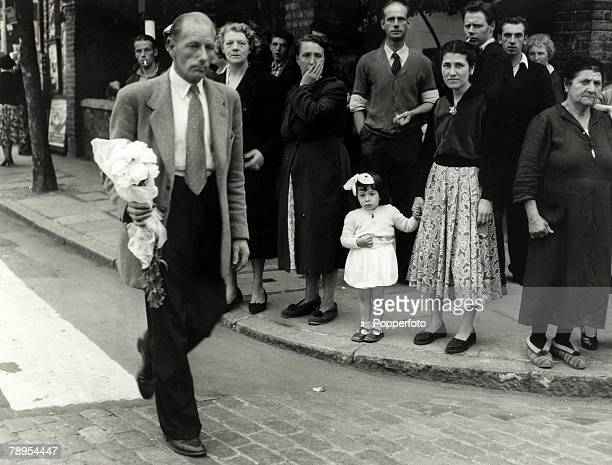 13th July 1955 Mr Julian Neilson the brother of Ruth Ellis arriving at Holloway Prison London with flowers shortly before the execution of his sister...
