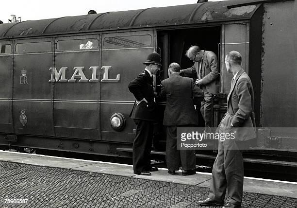 August 1963 Cheddington Buckinghamshire Detectives inspecting the Royal Mail train from which over 25million was stolen The Great Train Robbery took...
