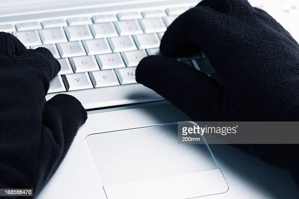 IT Crime  Hacker works on laptop
