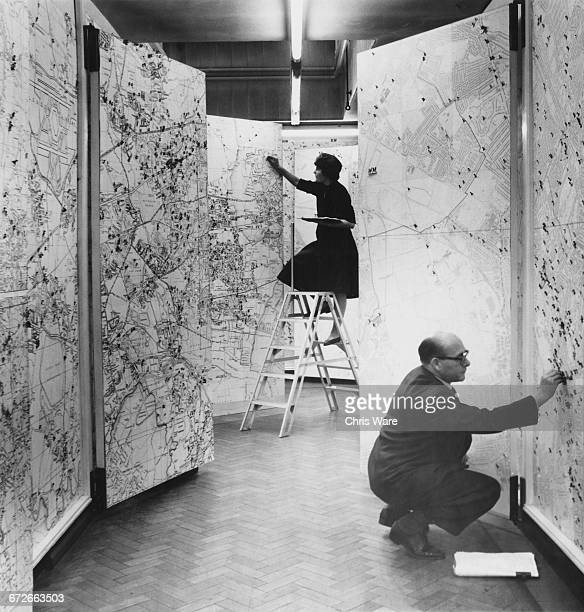 Crime locations are pinpointed on a large map of London in the map room at the New Scotland Yard building on the Victoria Embankment by the Thames at...