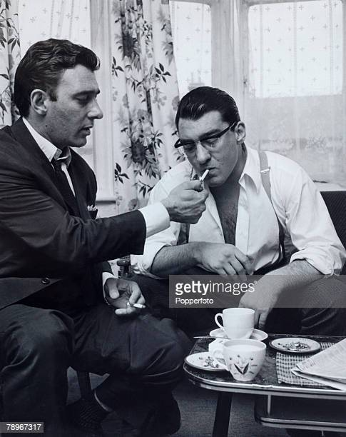 Crime London England Circa 1960's The Kray Twins Reg and Ronnie Kray smoking a cigarette and drinking tea