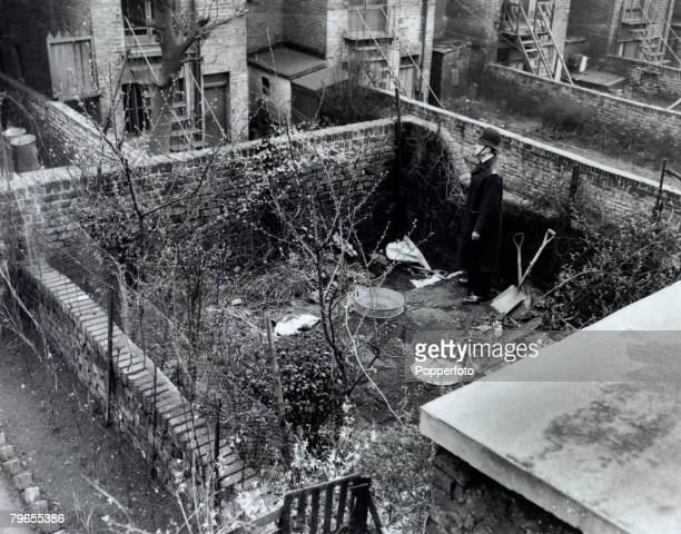 Crime London England The Christie Murder case A Policeman stands guard in the rear garden of 10 Rillington Place Notting Hill Home to John Reginald...