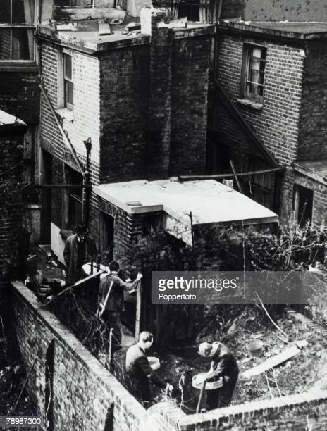 Crime London England The Christie Murder case Police dig in the rear garden of 10 Rillington Place Notting Hill Home to John Reginald Halliday...