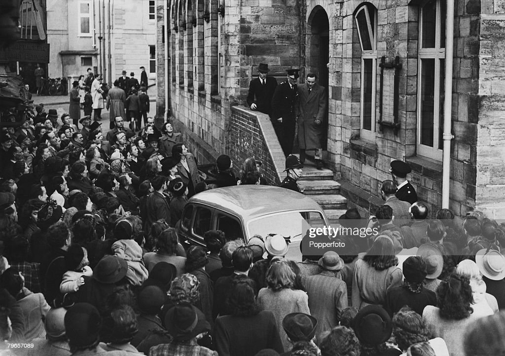 11th March 1949, Horsham, Sussex, John George Haigh pictured leaving the court during his trial as a large crowd surrounds his car, John George Haigh, the 'Acid Bath Murderer' was found guilty of the murder of Olive Durand- Deacon and 5 others, 1944-1949,and was hanged 10th August 1949