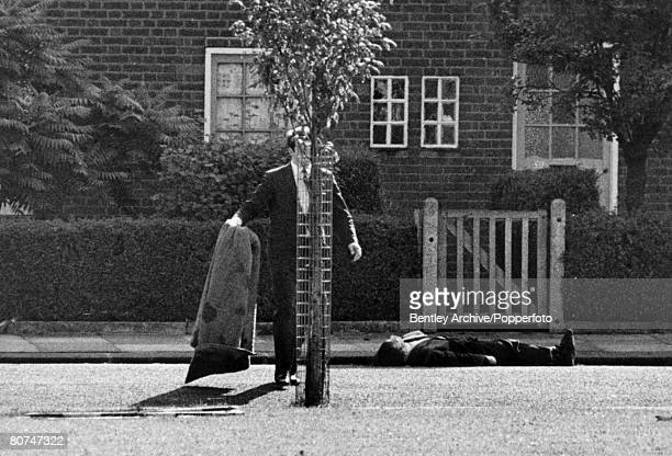 12th August 1966 Shepherd's Bush London A police office lies dead in the road after being shot dead by armed robbers Harry Roberts and his two...