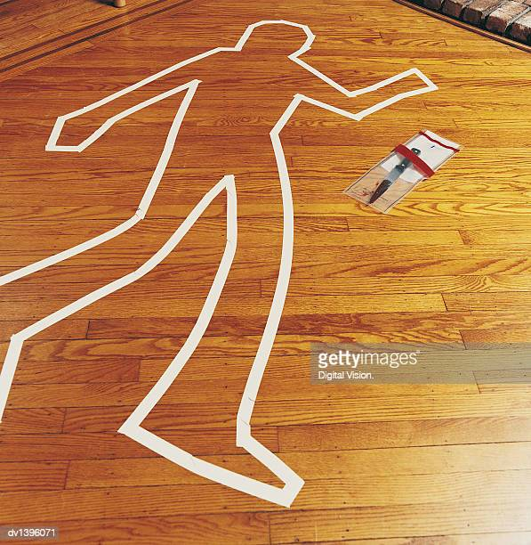 crime scene and a knife in an evidence bag - chalk outline stock pictures, royalty-free photos & images