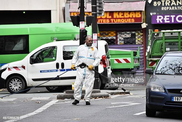A crime scene cleaner is pictured at the Rue de Charonne in Paris on November 14 following a series of coordinated attacks in and around Paris late...