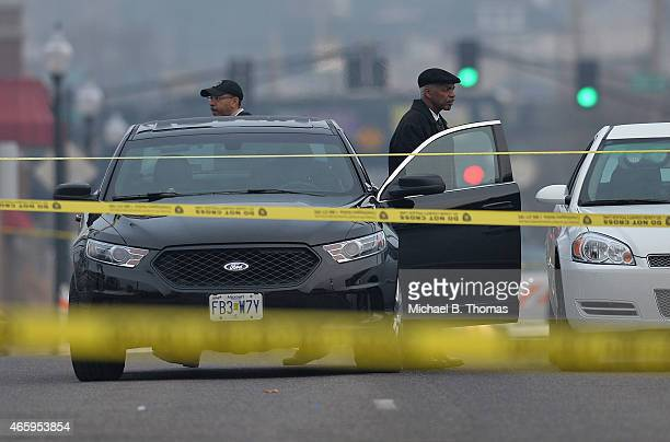 Crime scene detectives arrive to investigate the scene outside the Ferguson Police Department on March12 2015 in Ferguson MO Two police officers were...