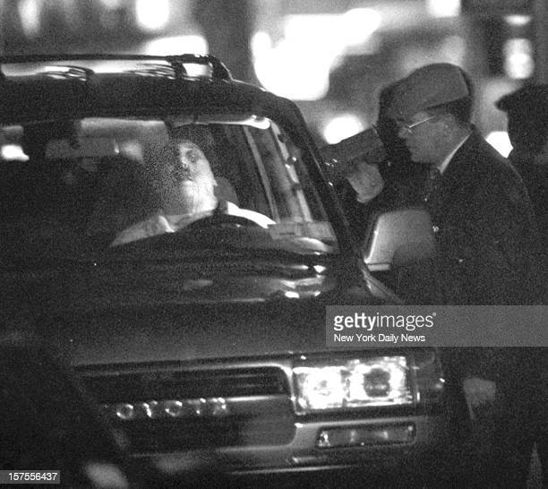 Crime scene detectives examine Nicholas Nicky Black Grancio a Colombo soldier shot behind the wheel of a car at Avenue U and McDonald Avenue in...