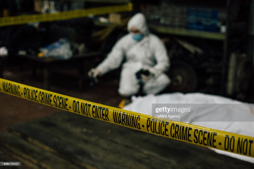 Crime Scene Investigation Dead Body Covered With A Sheet And