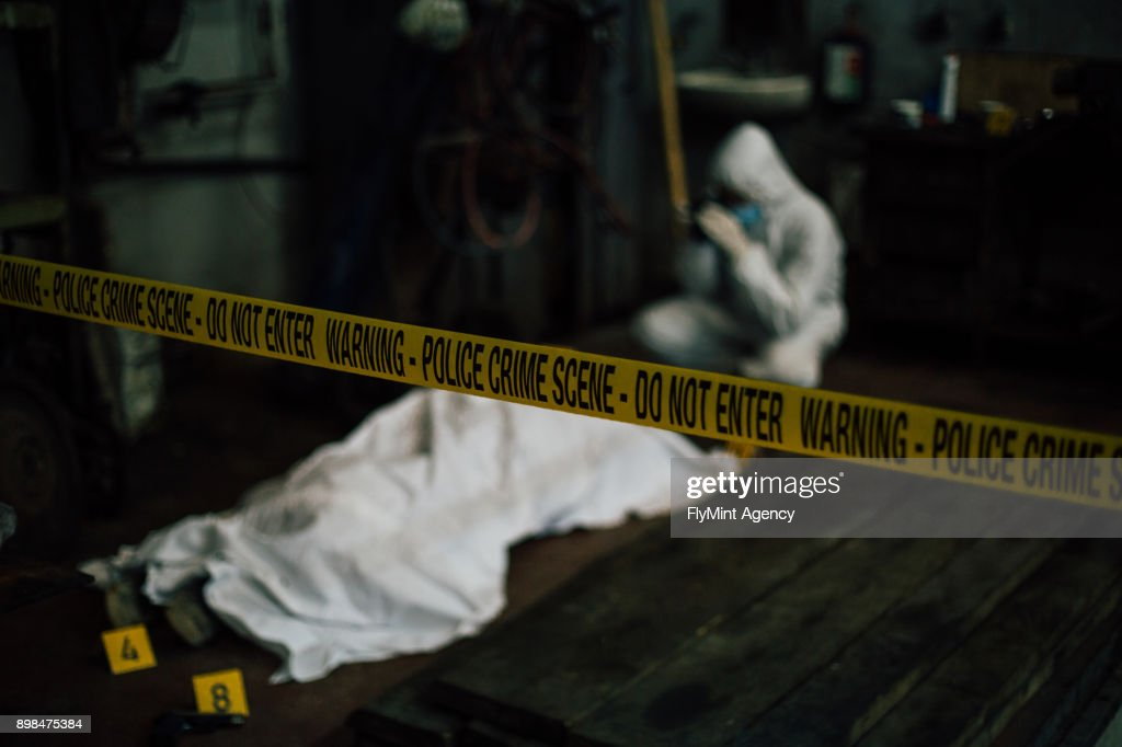 Crime scene investigation - forensic investigating behind dead cover body and evidence : Stock Photo