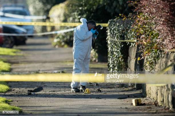 Crime scene investigator photographs the site of a car crash in which five people, including three children, were killed after a stolen car crashed...