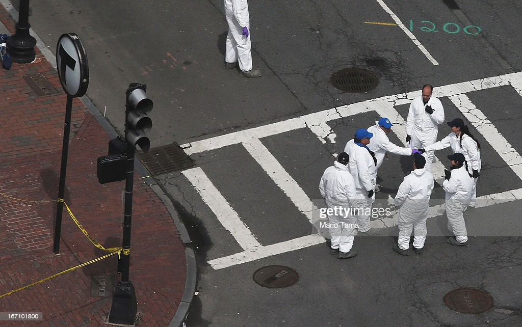 Crime scene investigators shake hands on Dartmouth Street at the corner Boylston Street near the scene of the Boston Marathon bombings on the day after the second suspect was captured with crime scene tape remaining (L) on April 20, 2013 in Boston, Massachusetts. A manhunt for Dzhokhar A. Tsarnaev, 19, a suspect in the Boston Marathon bombing ended after he was apprehended on a boat parked on a residential property in Watertown, Massachusetts. His brother Tamerlan Tsarnaev, 26, the other suspect, was shot and killed after a car chase and shootout with police. The bombing, on April 15 at the finish line of the marathon, killed three people and wounded at least 170.