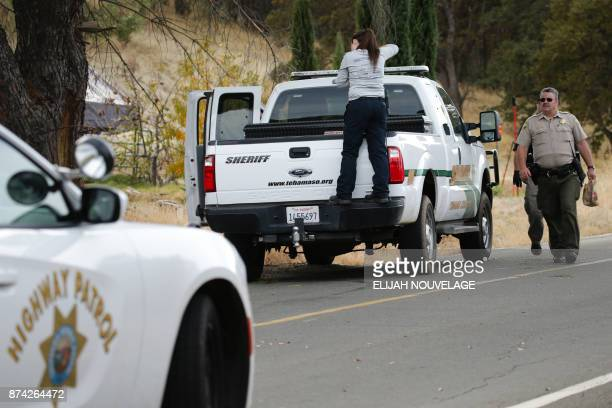 A crime scene photographer takes photos of a Sheriff's vehicle that was involved in a shooting on November 14 in Rancho Tehama California Four people...