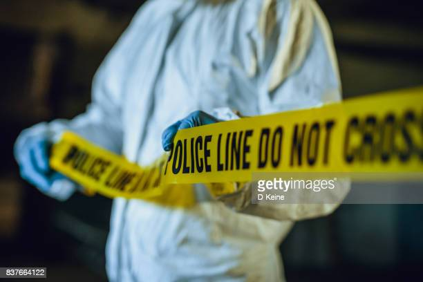 crime scene - cordon tape stock pictures, royalty-free photos & images