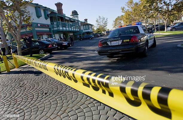 Crime scene tape at a mini mall where a deadly shooting occurred at Salon Meritage in Seal Beach leaving eight people dead one critically wounded and...