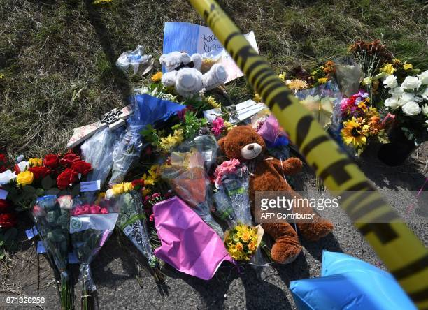 Crime scene tape beside a memorial outside the First Baptist Churchis seen after a mass shooting that killed 26 people in Sutherland Springs Texas on...