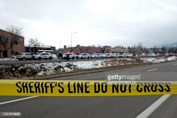 Crime scene tape closes off access to the King Soopers grocery store in Boulder, Colorado on March 22, 2021 after reports of an active shooter. -...