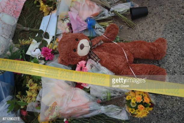Crime scene tape falls across a small memorial near the First Baptist Church of Sutherland Springs on November 7 2017 in Sutherland Springs Texas On...