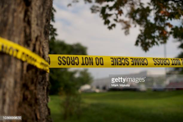 Crime Scene tape flutters in the wind in front of a Rite Aid Distribution Center where multiple people were killed and injured in a shooting on...