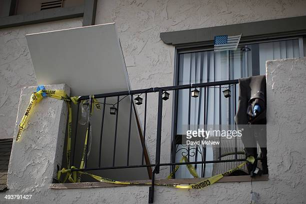 Crime scene tape hangs from an apartment balcony at a shooting site on Del Playa Drive May 25, 2014 in Isla Vista, California. According to reports,...
