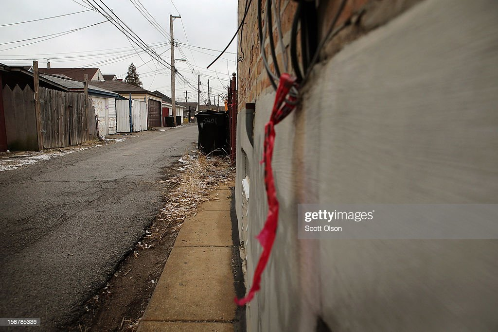 Crime scene tape hangs in the alley where Federico Martinez was gunned down two days ago on December 28, 2012 in Chicago, Illinois. Martinez was believed to be the 499th murder victim of the year in Chicago when he was killed on December 26. After news organizations began reporting about the city's 500th murder victim, the Chicago Police Department's News Affairs Office issued a statement stating Chicago's murder total remains at 499 because classification of one death investigation remains pending. They would not specify which death is pending. The total number of murders in the city has only once exceeded 500 victims since 2004. The murder rate is up about 11 percent from 2011, much of which is attributed to growing gang violence.