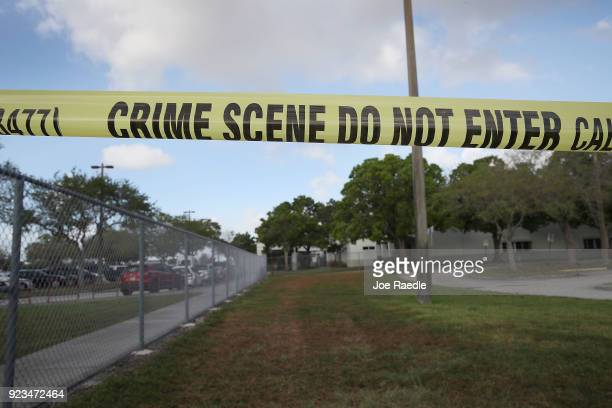 Crime scene tape is seen outside Marjory Stoneman Douglas High School as teachers and staff are allowed to return to the school for the first time...